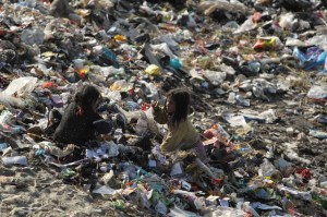Children living in a slum on the bank of Bagmati River search for recyclable material in Kathmandu